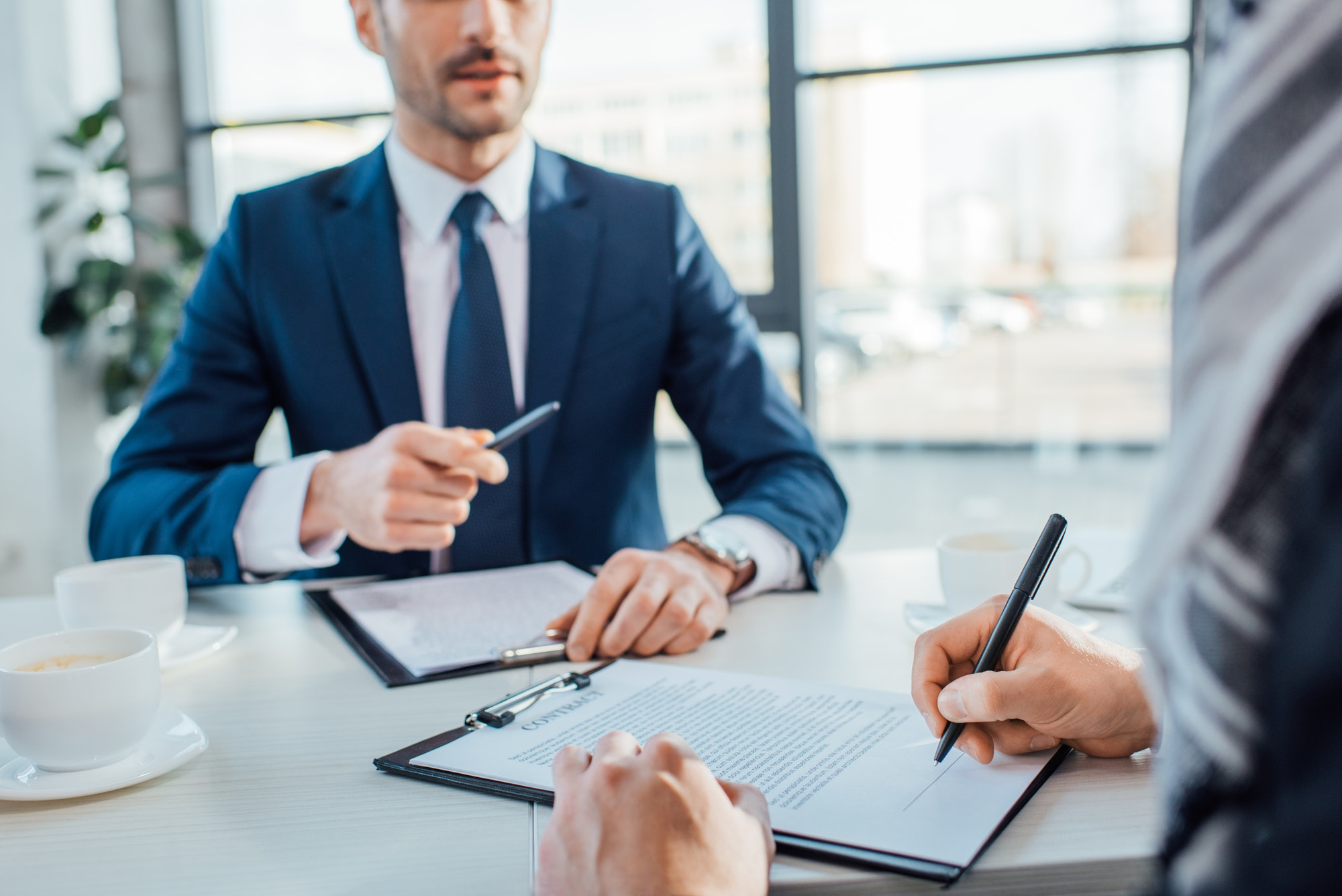 professional businessmen signing contract on meeting in modern office